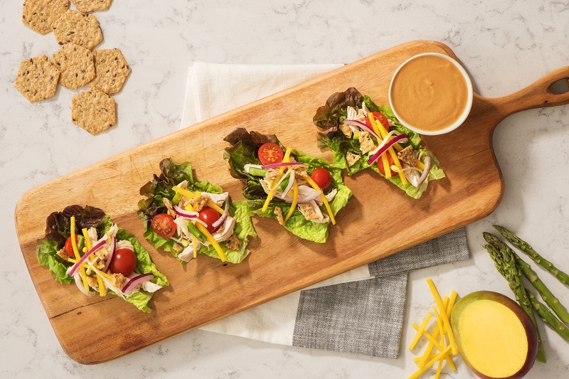 Chicken asparagus and mango lettuce wraps using Crunchmaster crackers for added texture.