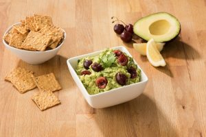Crunchmaster Multi-Grain crackers with lemon cherry guacamole.