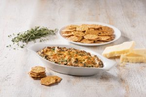 Warm spinach and artichoke dip with Cruncmaster crackers.