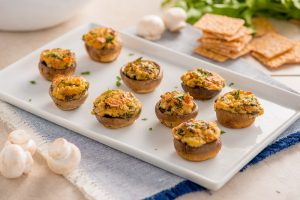 White cheddar stuffed mushrooms using Crunchmaster Multi-Grain crackers.